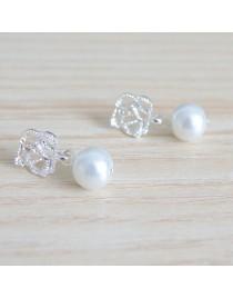 Boucles d'oreilles perle et feuille argentées