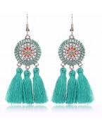 Boucles d'oreilles pendantes avec pompons, bleu